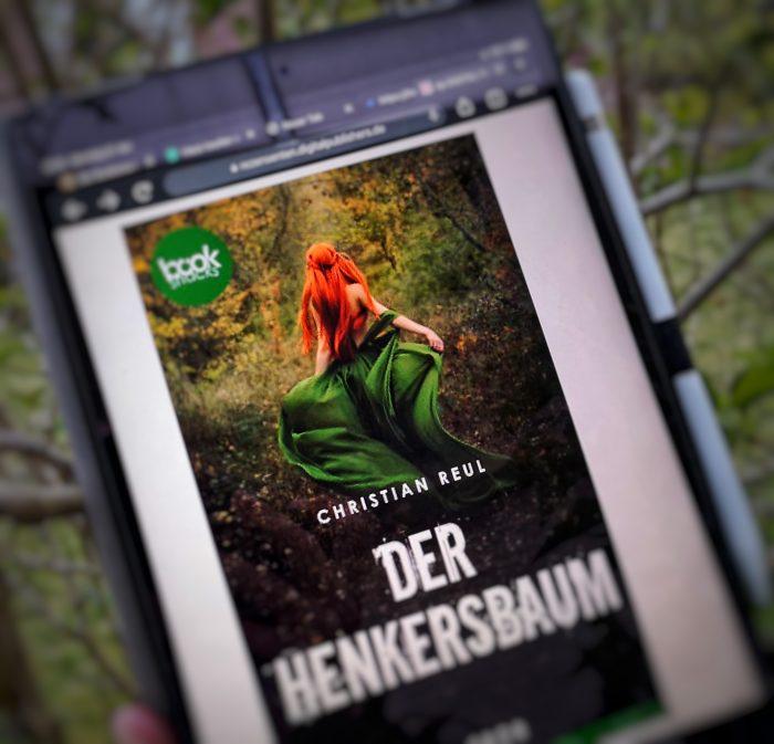 Der Henkersbaum. Cover mit einer rothaarigen Frau im grünen Kleid.